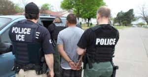 ICE arresting an immigrant.