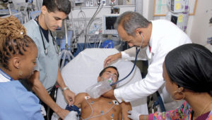 Healthcare: Doctors and Nurses treat a patient in a hospital