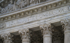 "The west facade of the Supreme Court Building bears the motto ""Equal Justice Under Law,"""