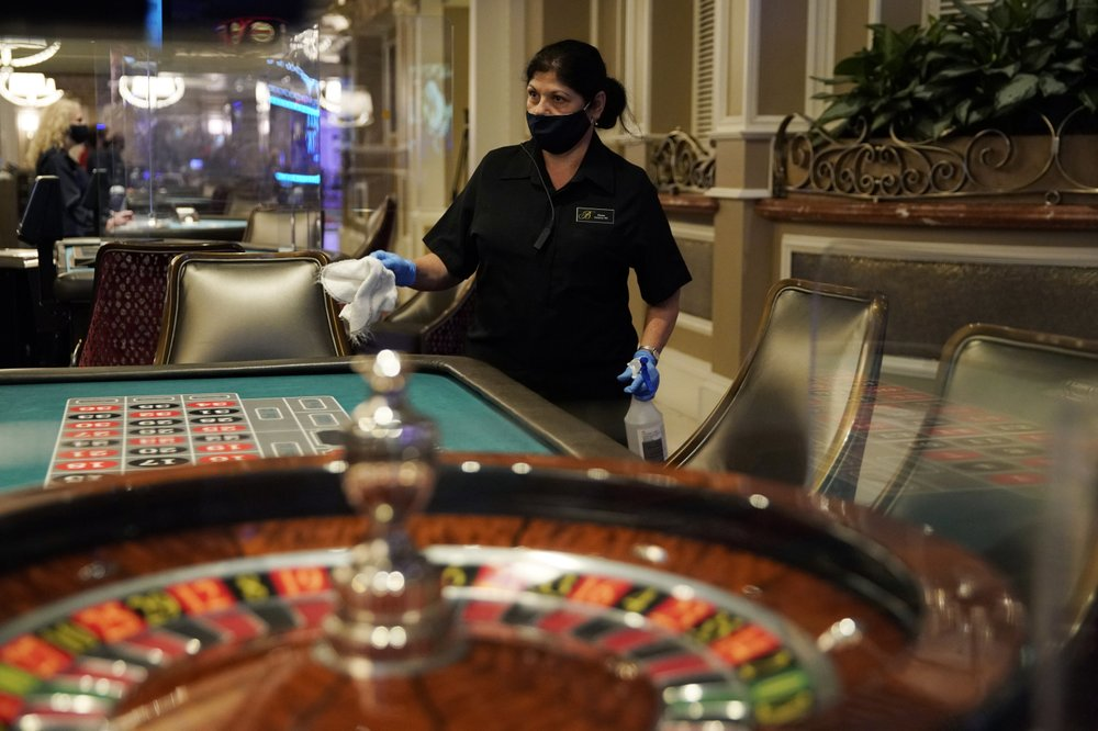 Las Vegas casino worker in a mask.