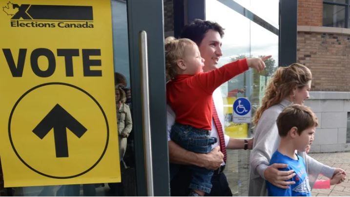 Voting Technology: Justin Trudeau voting with his family in Canada